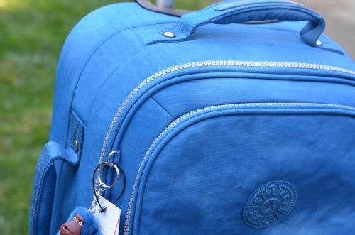 kipling blue rolling suitcase