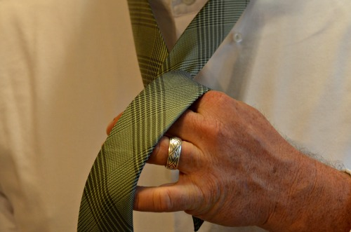 green necktie with stripes