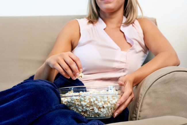 watching tv with bowl of popcorn