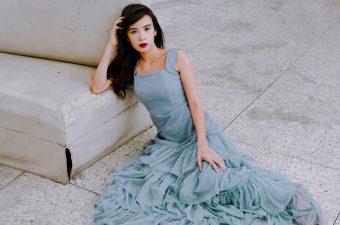 woman in formal dress sitting on floor