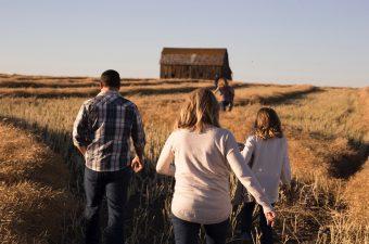 family walking in open field