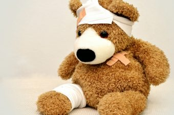 stuffed teddy bear with bandages