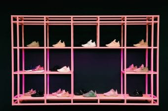 hot pink shoe rack with black background