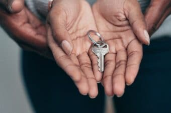 couple holding home key in hands