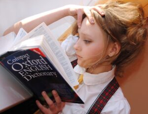 girl reading book in school outfit