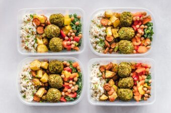 4 identical dishes of food in to-go like containers (meal prep)